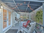 The Adirondack chairs and outdoor dining table make the porch comfortable and fun.