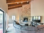 Unwind on the plush reclining sectional in front of the wood-burning fireplace.