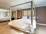The master bedroom features a canopied king-sized bed and an en-suite bathroom.