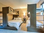 This custom-built bunk room features 3 twin beds and a queen bed.