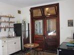 Kitchen with original double doors with over door transoms