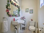 Freshen up in this quaint half bathroom.