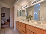 This Jack-and-Jill style bathroom is shared between the second and third bedroom.