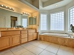 Find a large soaking tub, walk-in shower and double vanity in the en-suite bathroom.