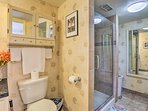The full bathroom features a lavish walk-in shower.
