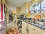 The kitchenette is equipped with a microwave, hot plate, coffee maker, and a large sink.