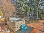 From the hot tub, to the pool, to the fun trampoline, this backyard space has it all!
