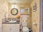 Wash up before dinner in the bathroom's single vanity.