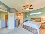 The expansive master bedroom boasts a queen-sized bed.