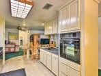 The fully equipped kitchen offers ample space and modern appliances.