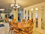 Gather around the 6-person dining table to savor meals.