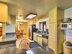 Utilize the spacious granite counter tops when preparing meals.