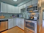 Prepare meals in the updated fully equipped kitchen with stainless steel appliances, granite countertops and tile...