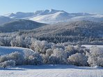 Lochnagar mountain and Albert's Cairn in snow from Knock Cottage
