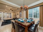 The dining area has seating for 8 at its large high top dining table