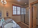 Double vanities and a walk-in shower are useful in this bathroom.
