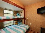 Second bedroom with one twin bunk, one double bunk, storage drawers under the bunk, TV & Cox cable!