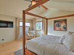 The master bedroom includes a flat-screen cable TV and king-sized bed.