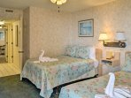 The bedroom features 2 full-sized beds.
