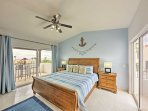 The upstairs master bedroom is bright and breezy with a king mattress.