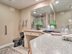The spacious full bathroom includes a pristine walk-in shower.