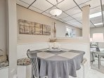 Share your family feasts at the dining table with booth seating.