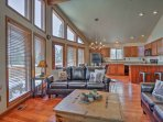 An open floor plan combines the living room, dining area and kitchen.
