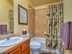 Get ready for bed in this bathroom with shower/tub combo.
