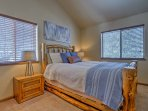 The second master bedroom also offers a queen bed.