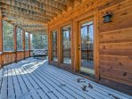 This home features log pine accents, vaulted ceilings, floor-to-ceiling windows, & spacious decks.