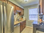 Utilize the stainless steel appliances found in the fully equipped kitchen for homemade meals.