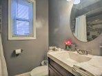 Wash up in the full bathroom's single vanity before dinner.