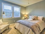 Enjoy peaceful slumbers on the full bed in the master bedroom.