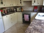 Fully fitted kitchen with washing machine, dishwasher and electric oven and hob