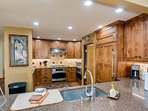 Gourmet kitchen with Subzero refrigerator. Two convect ovens. Five burner gas cooktop.