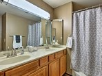 There's plenty of space to get ready in the master en-suite bathroom.