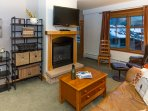 Comfortable furnishing plus shelving for books and games