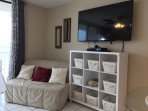 Large 55' flat screen tv; Ikea seating that rolls out in to a full size sleeper