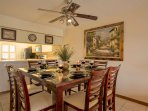 Rich cherry wood dinning room table with seating for 8