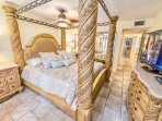 Master bedroom with a king bed and big screen TV.