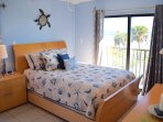 Master bedroom with a direct view of the ocean