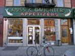 Russ & Daughters is a must for lox and smoked fish. They even let you taste first!
