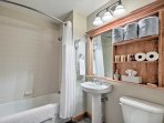 There is one pristine bathroom in the condo.