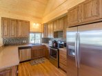 Kitchen with stainless steel appliances, including dish washer