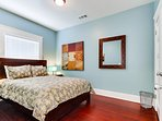 The guest bedroom also features a comfy queen-size bed