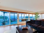 Floor-to-ceiling bay windows facing San Diegoo Harbor and downtown