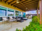 Large, cozy private patio with ample seating