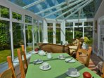Conservatory has extra seating for 4 and perfect for relaxing