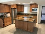 nicely remodeled kitchen.  there will be 3 barstools at island