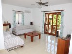 Lounge. Sette useful as 8th bed. Fireplace, AC, ceiling fan, french doors open to terrace & S pool